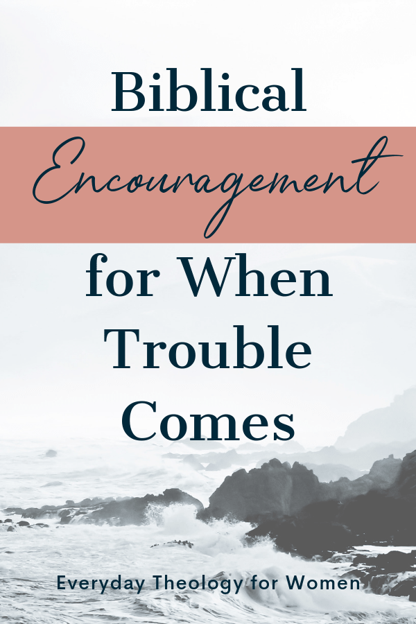 Biblical Encouragement for When Trouble Comes text over image of ocean crashing on rocks.
